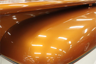 Hood painted with our Orange Copper candy over automotive paint black base.